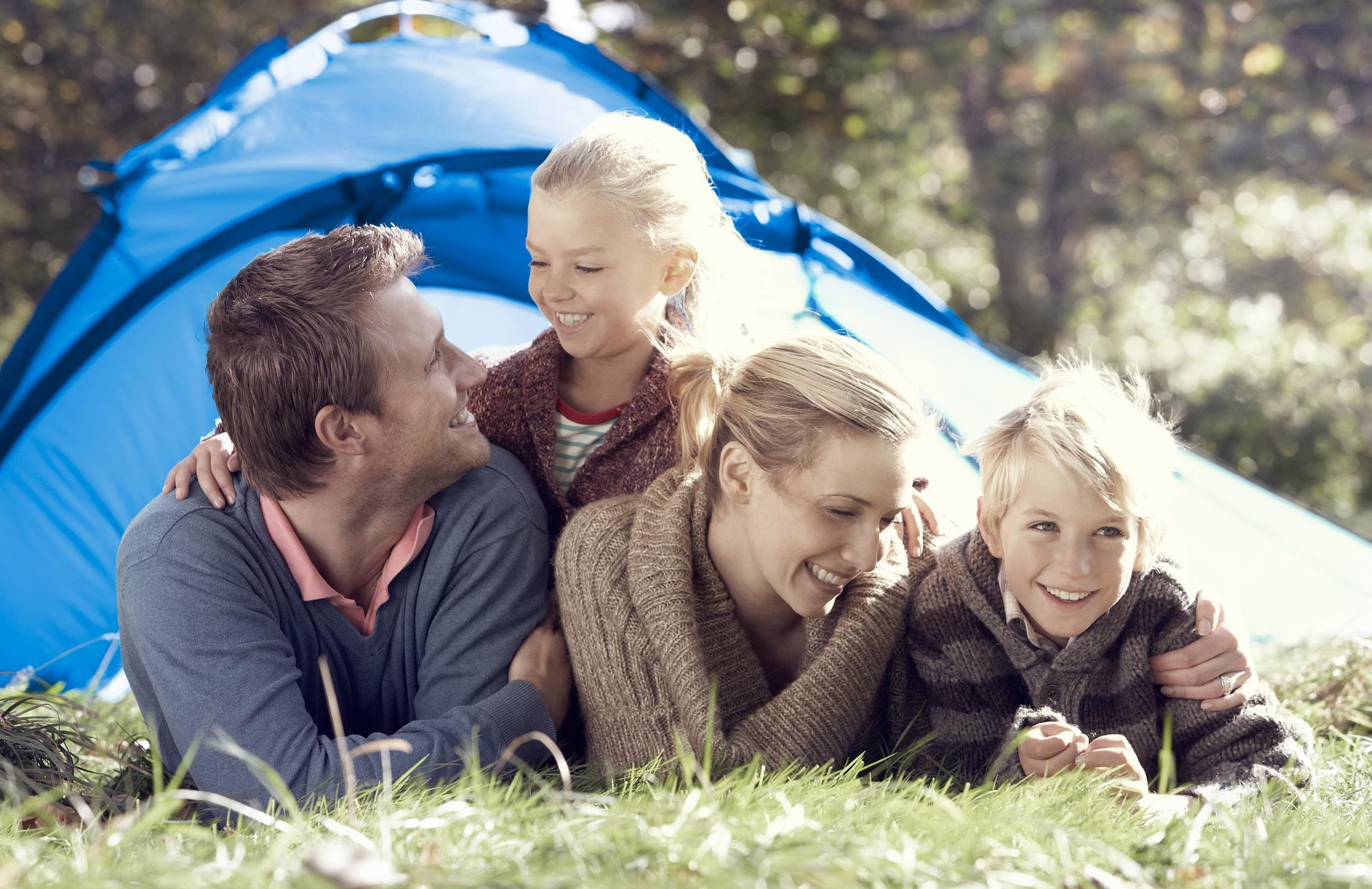Family is in front of a tent